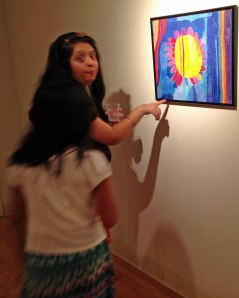 EC artist Yesenia Vargas found her drawing, while her niece danced through the photo.