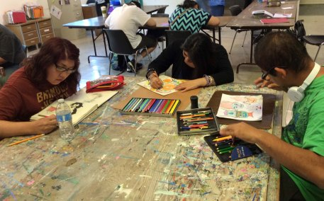 From left to right, EC artists Bianca Cheatum, Yadira Prado, and Luiz Anaya Gomez are working out sketches.